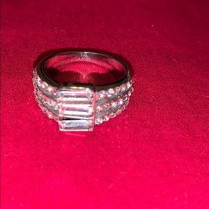 Costume jewelry ring, silver, possibly size 8